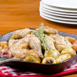 Roasted Cornish Game Hen and Potatoes Garnished with Sprig of Thyme — Stock Photo #12676363
