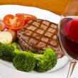 Stock Photo: Barbecued Rib Eye Steak Served with Vegetables and Glass of Red Wine
