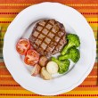 Barbecued Rib Eye Steak Served with Broccoli, Potatoes and Tomatoes — Stock Photo