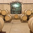 Foto Stock: Stack of Wine Barrels in Cellar