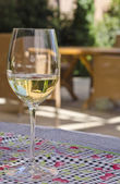 Glass of White Wine on a Patio Table — Stock Photo