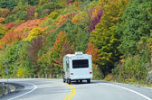 White Trailer on a Highway of Fall Colors — Stock fotografie