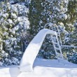Foto Stock: Water Slide Covered with Snow