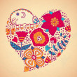 Heart of flowers and elephant — Stock Vector #32124473