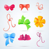 Set of color gift bows with ribbons — Stock Vector