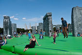 Jeremy Deller's Sacrilege a replica bouncy castle Stonehenge. — Stock Photo