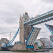 Stock Photo: Tower Bridge raises for May traditional Sail barge.
