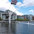London&amp;#039;s cable car, Emirates Air Line, passes over a Coot&amp;#039;s nest - Stock Photo