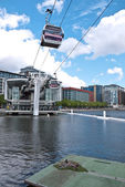 London's cable car, Emirates Air Line, passes over a Coot's nest — Stock Photo