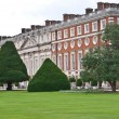 LONDON, UK-JULY 7: View of the Historic Royal Palace of Hampton Court developed by Henry V111 in from 1529, where the famous Hampton Court Flower Show is held each year. July 7, 2012 in London UK — Stock Photo #12241528