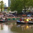 Narrow boats in traditional colours in London's Little Venice, wait for strat of annual Canalway Cavalcade. — Stock Photo #12380615