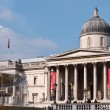 The National Gallery with Trafalgar Square fountain in the foreground. — Stock Photo