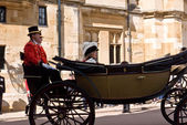 Queen Elizabeth riding in a carriage at Windsor Castle. — Stock Photo