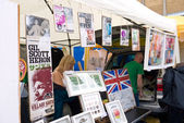 The Artist Swifty shows, prints and art work at the annual Vauxhall Art car Boot Fair in London's Brick lane. — Stock Photo