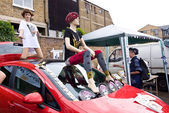 LONDON, UK- JUNE 19: Iconic Fashion Designer, musician and artist Pam Hogg's stall with car and Mannequins at the Annual Art Car Boot Fair in London's East End on June 19, 2011 in London UK. — Stock Photo