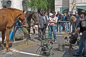 LONDON, UK-JUNE 23: Members of the ancient Worshipful Company of Farriers demonstrate the making and shoeing of horses in the street at Cheapside, City of London. June 23, 2012 in London UK — Stock Photo