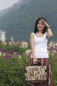 A Girl in the flower field — Stock Photo
