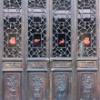 The wooden door of Chinese old house - Stock Photo