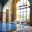 Hotel indoor swimming pool — Stock Photo