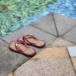 Stock Photo: Poolside slippers