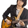 Stock Photo: Asian young musician playing guitar isolated on white background