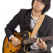 Asian young musician playing guitar isolated on white background — Stock Photo
