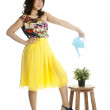 Attractive female with a watering can — Stock Photo #12794976