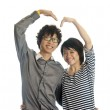 Romantic young couple making heart shape with arms — Stock Photo #12795065