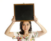 Asian female holding blackboard — Stock Photo