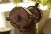 Old red fire hydrant — Stock Photo