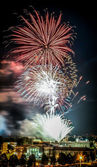 Fireworks over buildings — Stock Photo