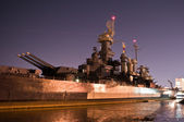 USS North Carolina arsenal at night — Stock Photo