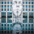 Stock Photo: Metalmorphosis is mirrored water fountain