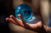 Crystal ball in hand — Stock Photo