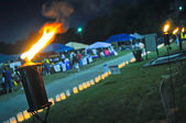 Burning torches at event — Stock Photo