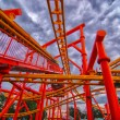 Rollercoaster in amusement park in summer — Stock Photo #18162627