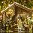 Stock Photo: Old handmade nativity scene in front of christmas tree