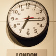 Timezone clocks showing different time — Stock Photo