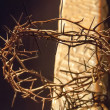 图库照片: Crown of thorns hung around Easter cross