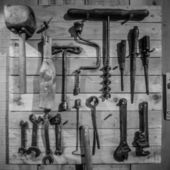 Old tools on the wall — Stock Photo