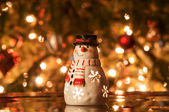 Festive snowman with Christmas light background — Stock Photo