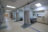 Looking down a hospital hall way — Stock Photo