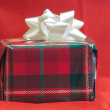 Royalty-Free Stock Photo: Christmas present isolated on red