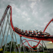 Rollercoaster amusement park ride - Stock Photo