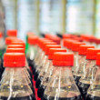 Rows of soda bottles — Stock Photo