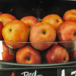 Apples on shelf at the supermarket on display — Stock Photo
