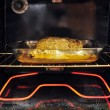 Stock Photo: Pork tenderloin in oven baking