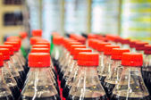 Rows of soda bottles — Stock Photo