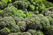 Broccoli in a pile on a farm stand — Stock Photo
