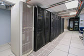 Modern interior of server room in datacenter — Stock Photo